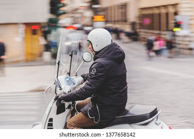 Rome, Italy - April 3, 2019: Senior man riding a motobike in the streets of Rome, Italy.