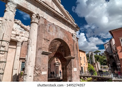 Rome, Italy - April 7, 2019: View from the old Jewish Ghetto of Rome on April 7, 2019. Pillars of Porticus Octaviae, the Port of Octavia and people walking around.