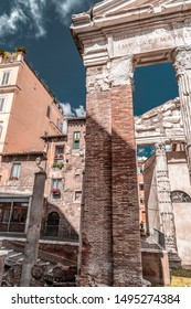 Rome, Italy - April 7, 2019: View from the old Jewish Ghetto of Rome on April 7, 2019. Pillars of Porticus Octaviae, the Port of Octavia.