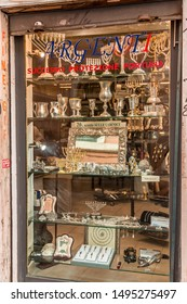 Rome, Italy - April 7, 2019: Shop window of a silver souvenir store selling special Judaism related objects such as wine cups, menorahs, prayer plates in the old Jewish Ghetto of Rome.
