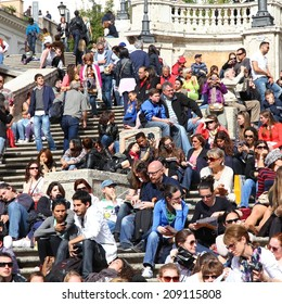 ROME, ITALY - APRIL 8, 2012: People sit on famous Spanish Steps in Rome. According to Euromonitor, Rome is the 3rd most visited city in Europe (5.5m international tourist arrivals 2009)