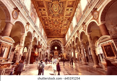 ROME, ITALY - APRIL 8, 2012: People visit Basilica Santa Maria in Aracoeli on April 8, 2012 in Rome. The famous romanesque church dates back to 12th century.