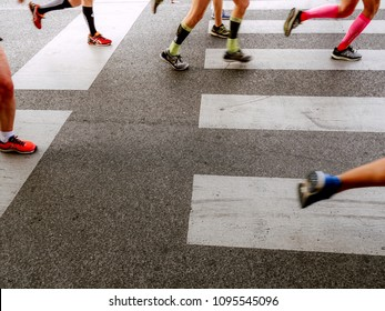Rome, Italy - April 8, 2018: group legs runners running crosswalk in Rome Marathon and Run for Fun