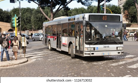 ROME, ITALY - APRIL 9, 2012: People ride Iveco bus operated by ATAC on April 9, 2012 in Rome. With 350 bus lines and 8000 bus stops, ATAC is one of the largest bus operators in the world.