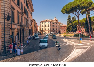 """ROME, Italy - August 09, 2017: Street traffic in Rome """"Via del Teatro di Marcello"""" street, Italy"""