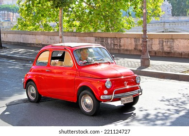 ROME, ITALY - AUGUST 1, 2014: Red tiny car Fiat 500 at the city street.