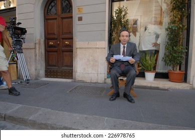 """ROME, ITALY - AUGUST 12, 2011: Italian actor Roberto Benigni during the filming of the movie """"To Rome with Love"""", directed by Woody Allen. A break in the film."""