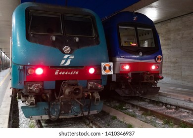 Rome, Italy - August 12, 2018: Trenitalia train waiting on station tracks. Primary train operator in Italy, Trenitalia is owned by Ferrovie dello Stato Italiane, itself owned by the Italian Government