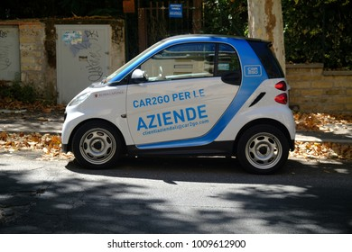 Rome, Italy - August 13, 2017: parked Car2Go Smart car. Car2Go is a subsidiary of Daimler AG providing car-sharing services in European and North American cities