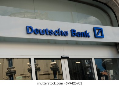 Rome, Italy - August 15, 2017: Sign outside a branch of the Deutsche Bank. It is a German global banking and financial services company with its headquarters in Frankfurt
