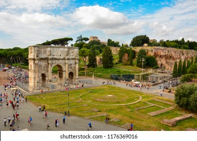 Rome / Italy — August 16, 2014: view of Rome from Colosseum with triumphal Arch of Constantine and Palatine Hill, one of the seven hills of Rome and a place where the emperors' palaces were built