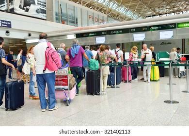 ROME, ITALY - AUGUST 16, 2015: passenger check-in area in FCO airport. Fiumicino - Leonardo da Vinci International Airport is a major international airport in Rome, Italy