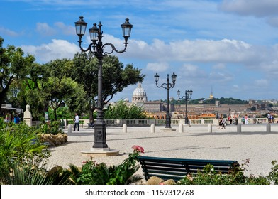 Rome / Italy — August 17, 2010: a panoramic view of Vatican City with the dome of St Peter's Basilica and the Vatican radio tower from the Pincian Hill (Pincio) gardens
