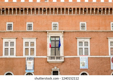 ROME, ITALY - AUGUST 17, 2014: The Palazzo Venezia with tourists walking on the street. Formerly Palace of St. Mark in central Rome, Italy