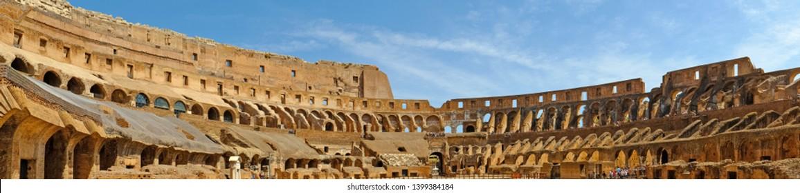 Rome, Italy - August 19, 2017: Interior panorama of the Coliseum Flavian amphitheater (Anfiteatro Flavio, Colosseo). Inside the of Colosseum, famous tourist landmark. Antique roman gladiator arena.