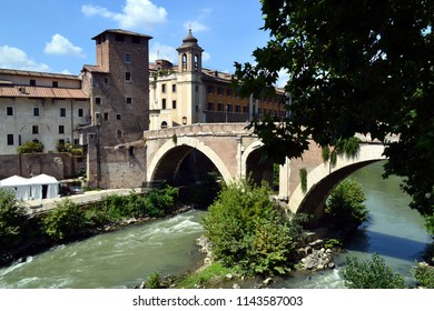 ROME, ITALY - AUGUST 2, 2016: Old bridge over the Tiber River in Rome