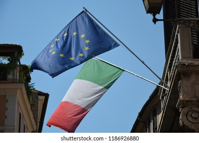 ROME, ITALY - AUGUST 21, 2018: Italian and European Union flags on a street