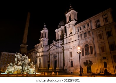 ROME, ITALY - AUGUST 27 2011: Night version of Navona Square, with church and fountain illuminated.