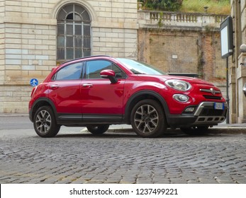 Rome, Italy - August 3, 2018: Red Fiat 500 car. Side view. Fiat Automobiles SpA is the largest automobile manufacturer in Italy, subsidiary of FCA Italy SpA, which is part of Fiat Chrysler Automobiles