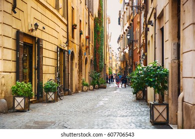 ROME, ITALY - AUGUST 31, 2016: tourists strolling along Via dei Coronari - a picturesque historic center of Rome, Italy