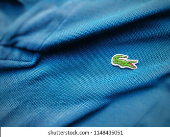 Rome, Italy, august 3rd 2018: close up view of a Lacoste blue shirt. Focus on the sewn crocodile