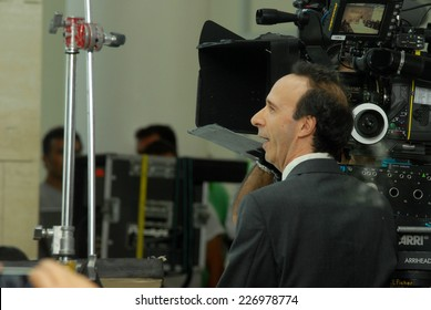 """ROME, ITALY - AUGUST 8, 2011: Italian actor Roberto Benigni during the filming of the movie """"To Rome with Love"""", directed by Woody Allen. A break in the film."""