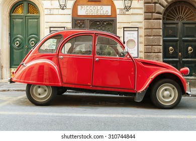 Rome, Italy - August 9, 2015: Red oltimer Citroen 2cv6 Special car stands parked on the city roadside, side view