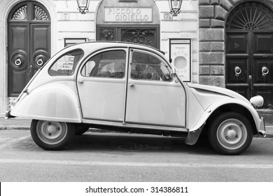 Rome, Italy - August 9, 2015: Old-timer Citroen 2cv6 Special car stands parked on the city roadside, side view