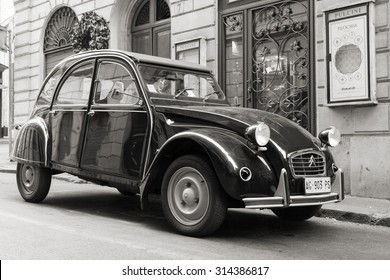 Rome, Italy - August 9, 2015: Old-timer Citroen 2cv6 Special car stands parked on the city roadside