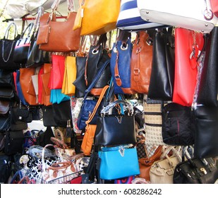 ROME, ITALY - AUGUST 9, 2016: Fake designer fashion bags at the city center market in Rome, Italy. Popular place for shopping different good or bad quality bags in italian capital