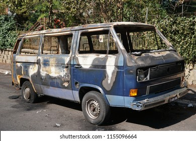 Rome, Italy - August 9, 2018: Completely burnt out van