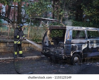 Rome, Italy - August 9, 2018: Firefighters at work extinguishing a van fire