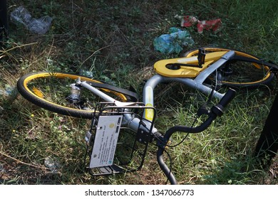 Rome, Italy - August 9, 2018: OBike bicycles lying on grass. oBike is a Singapore-registered stationless bicycle-sharing system. The bikes have a built-in Bluetooth lock therefore can be left anywhere