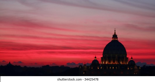 Rome, Italy, black silhouette of Vatican Basilica at dusk on red magenta sky. Panoramic shot.