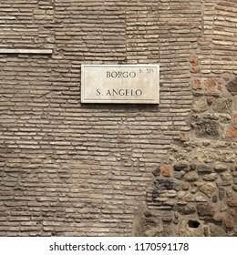 Rome, Italy. Borgo San Angelo - street name on ancient city walls.