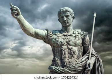 Rome, Italy, Bronze statue of Emperor Augustus (Gaius Iulius Cæsar Octavianus Augustus) on a stormy sky background.