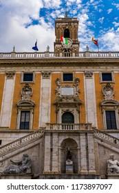 Rome, Italy Capitoline Hill Senatorial Palace facade. External day view of Palazzo Senatorio at piazza del Campidoglio with Italian and city of Rome flag.
