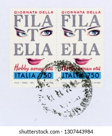 ROME, ITALY - CIRCA FEBRUARY 2019: a stamp printed by Italy showing Philately ageless hobby (Filatelia hobby senza eta)
