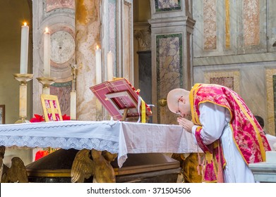 ROME, ITALY - CIRCA JANUARY 2016 - A priest saying the traditional extraordinary tridentine latin rite of the Catholic mass in the basilica of St Nicholas in Rome