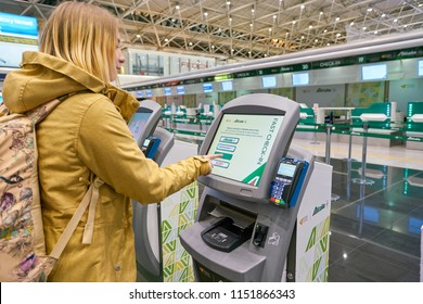 "ROME, ITALY - CIRCA NOVEMBER, 2017: woman use self check-in kiosks in Fiumicino International Airport ""Leonardo da Vinci"""