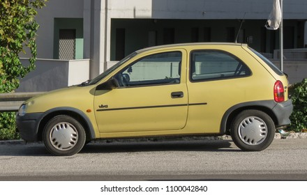 ROME, ITALY - CIRCA OCTOBER 2015: yellow Opel Corsa Viva car parked in a street of the city centre