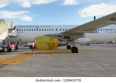 ROME, ITALY- CIRCA OCTOBER 2015: Vueling aircraft Airbus A320 parked at the airport
