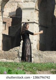 ROME, ITALY - CIRCA OCTOBER 2018: Asian tourist taking a selifie by the Colosseum (Colosseo) aka Coliseum
