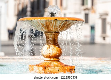 Rome, Italy Closeup of Fountain in Piazza in historic city street with drops spraying splashing, detail, nobody, sunny summer day