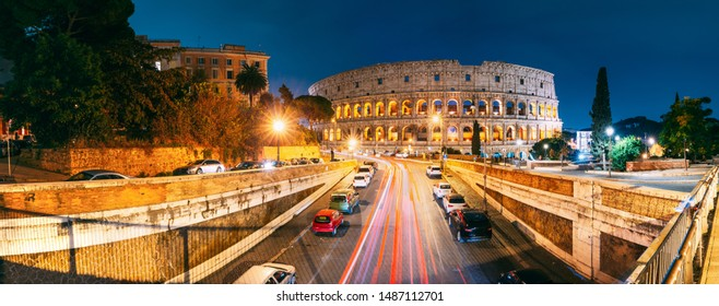 Rome, Italy. Colosseum Also Known As Flavian Amphitheatre. Traffic In Rome Near Famous World Landmark In Evening Time. Famous World Landmark UNESCO