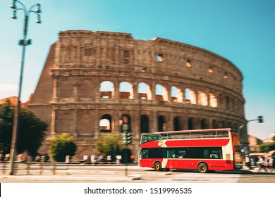 Rome, Italy. Colosseum. Red Hop On Hop Off Touristic Bus For Sightseeing In Street Near Flavian Amphitheatre. Famous World UNESCO Landmark. City Sightseeing Tour.