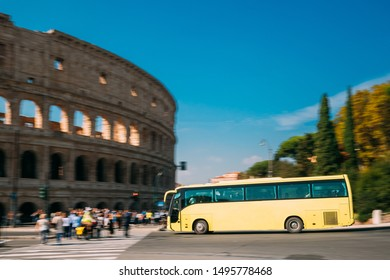 Rome, Italy. Colosseum. Yellow Bus Moving On Street Near Flavian Amphitheatre.