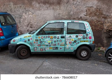Rome, Italy. December 05, 2017: Car stickers cover a blue car on the street.