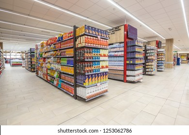 ROME, ITALY. December 05, 2018: Lanes of shelves with goods products inside a MA supermarket in Italy in Rome. Variety of packaged foods. Shelves full and tidy.