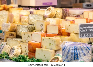 ROME, ITALY. December 05, 2018: Gastronomy, cheese department inside a MA supermarket in Italy in Rome. Variety of Italian cheeses. Showcase with different dairy products.